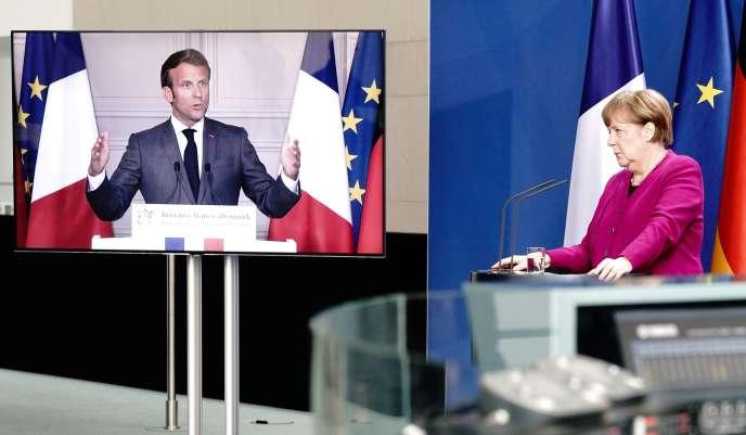 La chancelière allemande Angela Merkel et le président Emmanuel Macron, lors d'une conférence de presse commune, le 18 mai à Berlin.